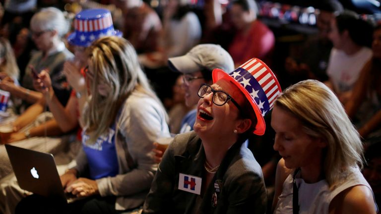 Despondent Hillary Clinton supporters watch another state go in Donald Trump's favour