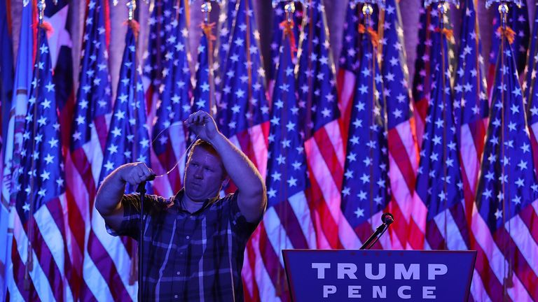 NEW YORK, NY - NOVEMBER 08: A worker prepares the teleprompter in the election night room for Republican presidential nominee Donald Trump at the New York Hilton Midtown on November 8, 2016 in New York City. Voters head to the polls to decide the next President of the United States. (Photo by Joe Raedle/Getty Images)