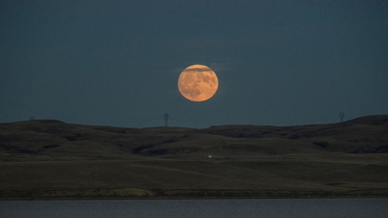 The supermoon rises over the Missouri River, pictured from the Standing Rock Indian Reservation near Cannon Ball, North Dakota, U.S. November 13, 2016