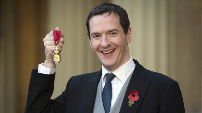 Former Chancellor George Osborne poses with the Order of the Companions of Honour
