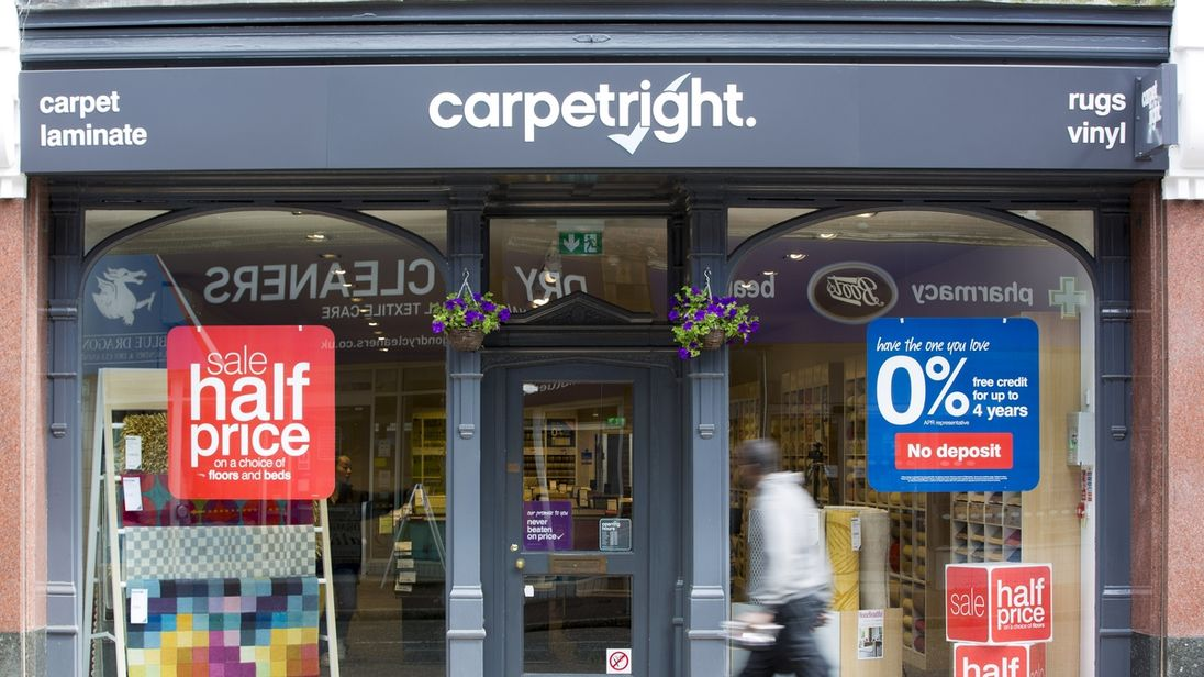 Carpetright's first-half profits fell 42%
