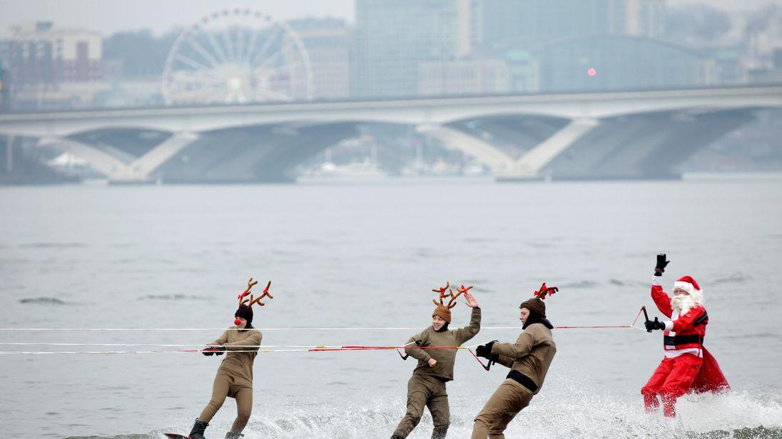 A water-skiing Santa and his knee-boarding reindeer in Alexandria, Virginia