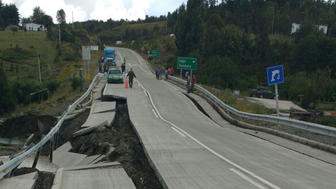 A road is ripped apart by the powerful quake