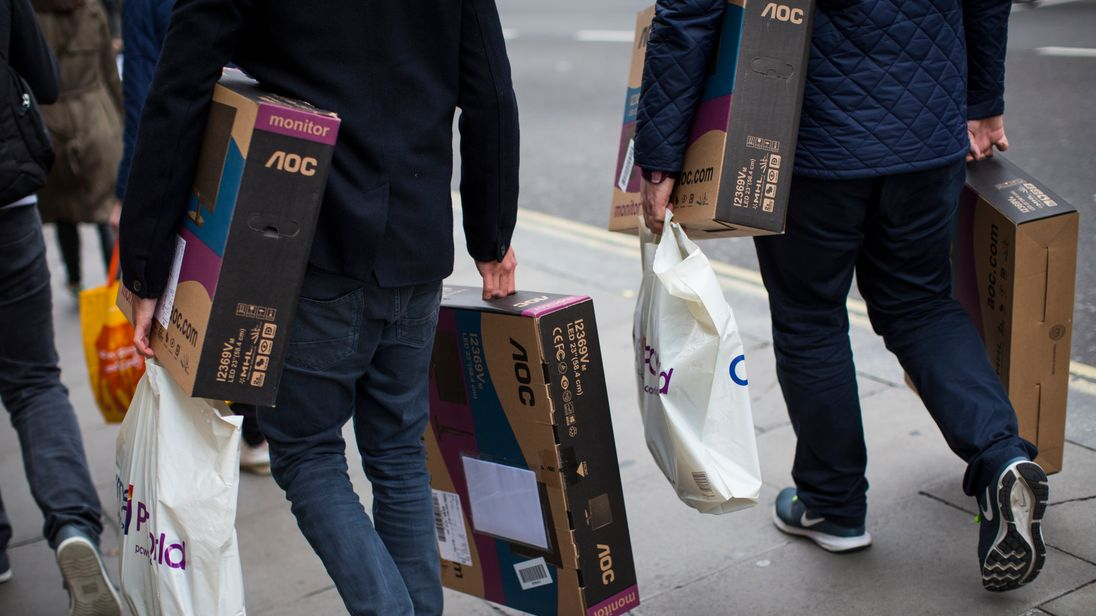 Shoppers carry boxed LED monitors on Oxford Street on October 19, 2016 in London, England. Inflation rose to 1.0% in September up from 0.6% in August, according to the Office for National Statistics, hitting those on lower incomes the hardest