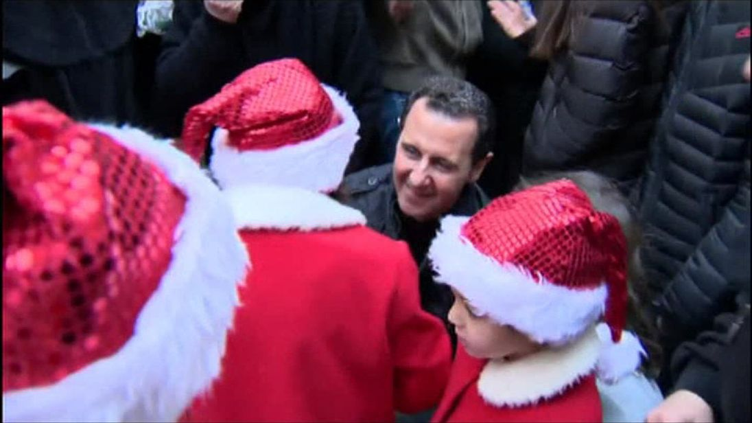 President Assad on his visit to the orphanage