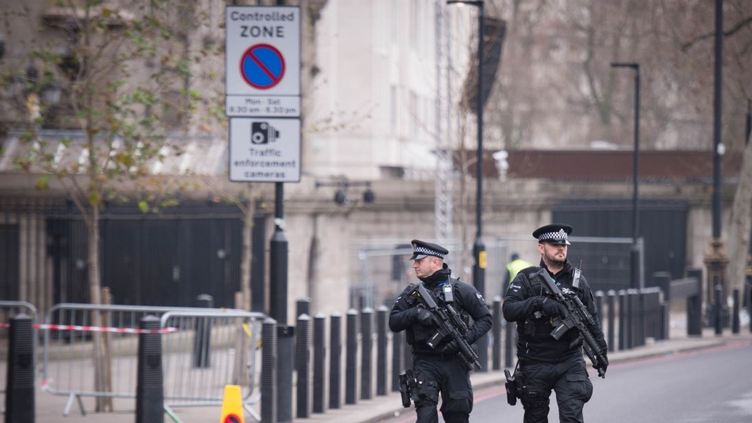 Armed police officers are patrolling central London