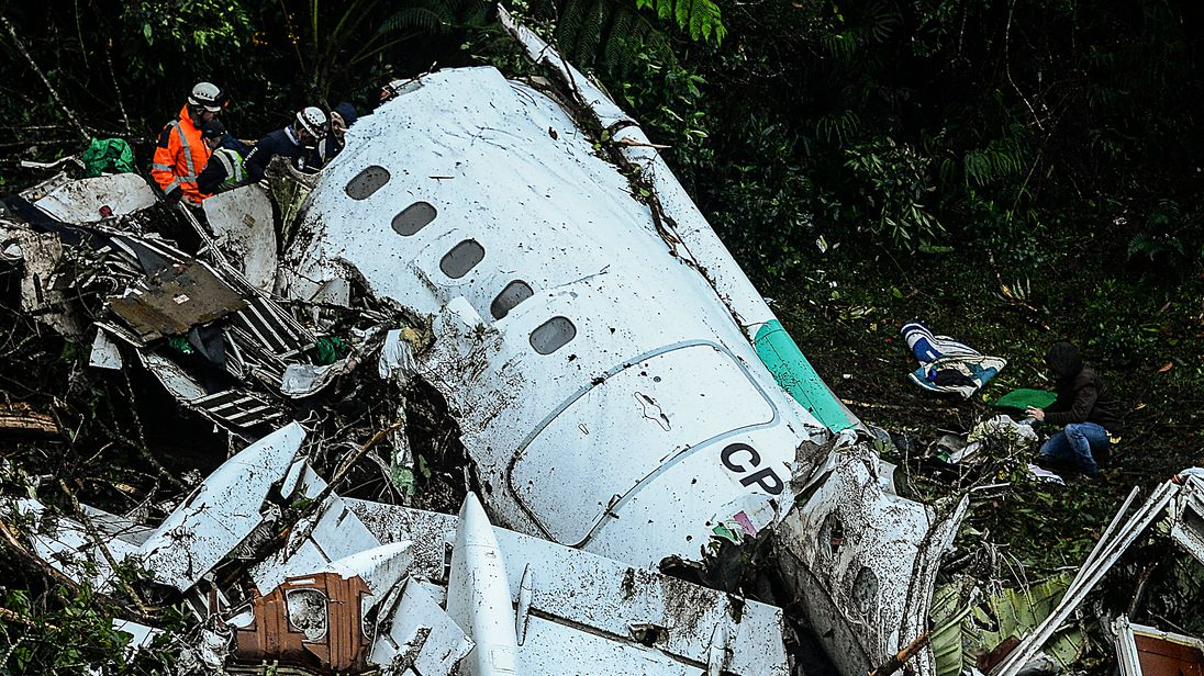 Rescue teams work to recover bodies after the Colombia plane crash