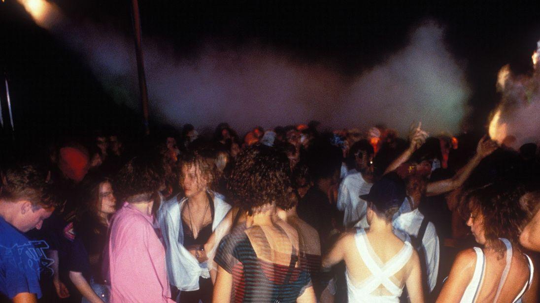 Ravers dancing in in a field, Tribal Dance rave M25 Orbital, East Grinstead, 1 Aug 1989