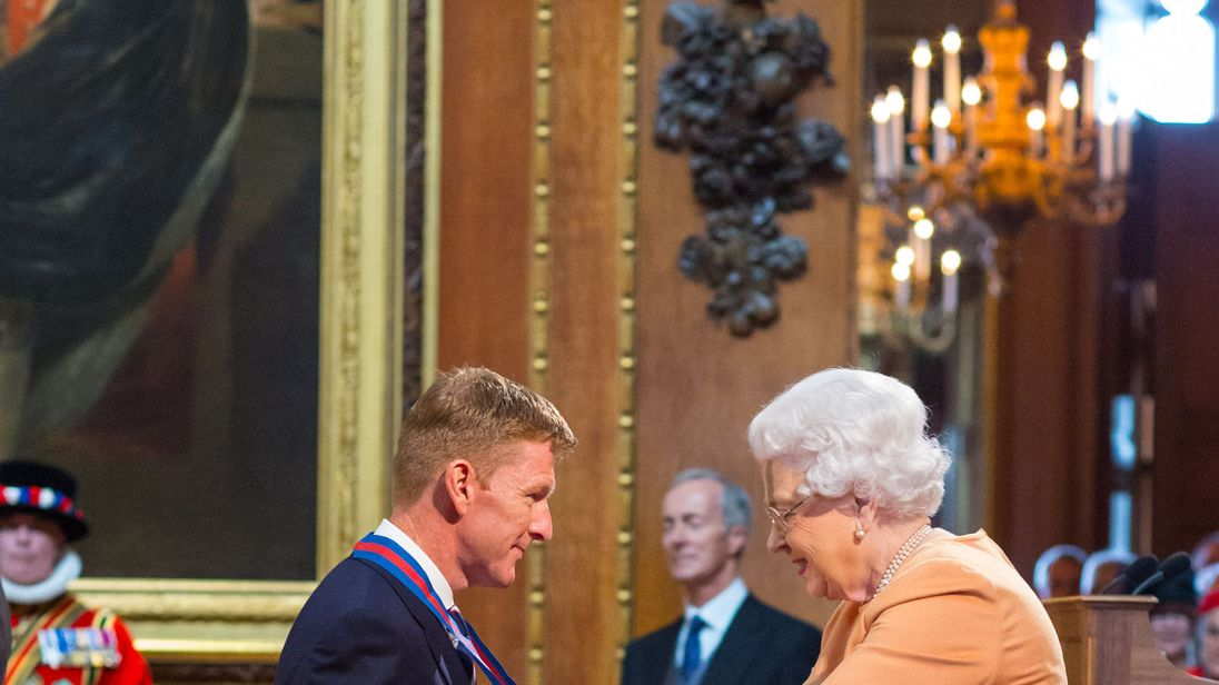 Major Tim Peake receiving his honour from the Queen