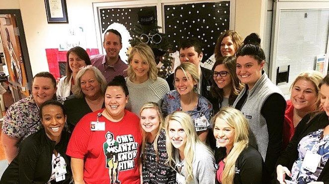 Jennifer Lawrence poses with staff at Norton Children's Hospital in Louisville