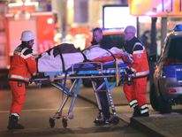 A person injured when a lorry crashed into a Christmas market is taken to hospital by paramedics