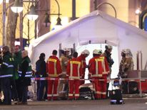 Rescue workers gather with stretchers outside a tent in the area after a lorry truck ploughed through a Christmas market on December 19, 2016 in Berlin, Germany.