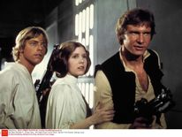 Carrie Fisher starred in Star Wars with Mark Hamill and Harrison Ford