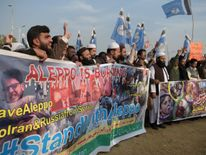 Pakistani Muslim students, shout slogans during a demonstration in Islamabad on December 16, 2016, against the ongoing conflict in Syria. The Syrian government on December 16, has suspended an operation to evacuate civilians and fighters from the last rebel-held parts of Aleppo, accusing the opposition of violating the deal, a security source said