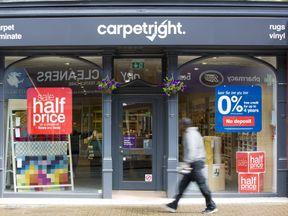 Carpetright's first-half profits fell 42%