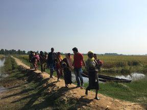 Rohingya refugees crossing the border into Bangladesh