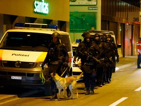 Police stand outside an Islamic center in central Zurich, Switzerland December 19, 2016