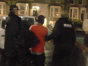 A man is arrested following a raid at a property in Stoke Newington, north-west London