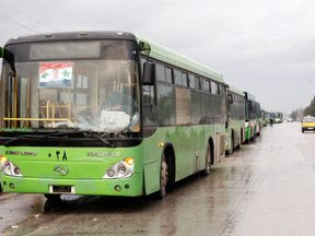 Buses wait to evacuate people from a rebel pocket in Aleppo