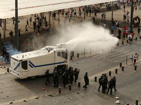 Police fire water cannons to control the fighting after football fans clashed ahead of the England vs Russia France Euro 2016 match.  Read less