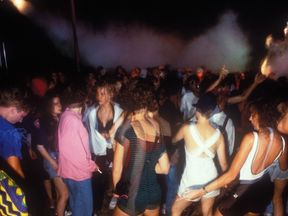 Ravers dancing in in a field, Tribal Dance rave M25 Orbital, East Grinstead, 1 Aug 1989