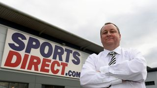 Mike Ashley outside a Sports Direct store