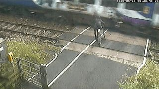 Network Rail CCTV of a cyclist coming within inches of being killed by a train