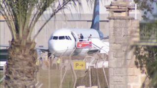 Passengers disembarking from hijacked Libyan aircraft in Malta