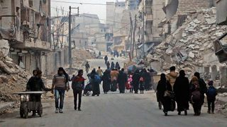 Syrian civilians flee the Sukkari neighbourhood of Aleppo