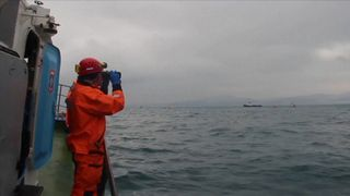 Search teams look for debris and bodies in the Black Sea