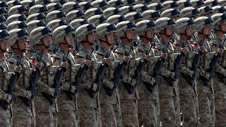 Soldiers march during a military parade in Beijing in September 2015