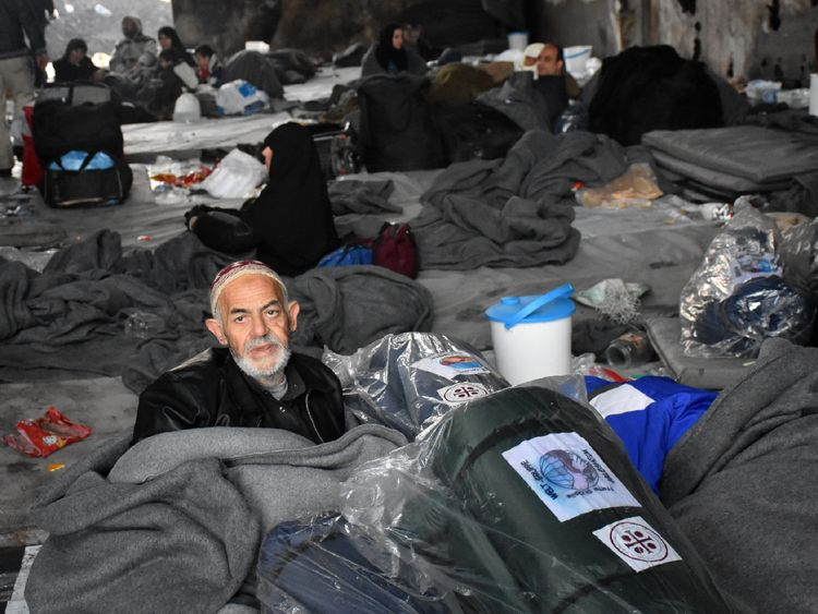 Syrians who fled from rebel-held areas in east Aleppo gather on December 1, 2016 at a warehouse turned into shelter in Duweirineh, a small village on the eastern outskirts of the embattled city. More than 50,000 Syrians have joined a growing exodus of terrified civilians from the besieged rebel-held east of Aleppo, the Syrian Observatory for Human Rights monitor said, as the UN Security Council was set for emergency talks on fighting in the city. / AFP / George OURFALIAN (Photo credit should rea