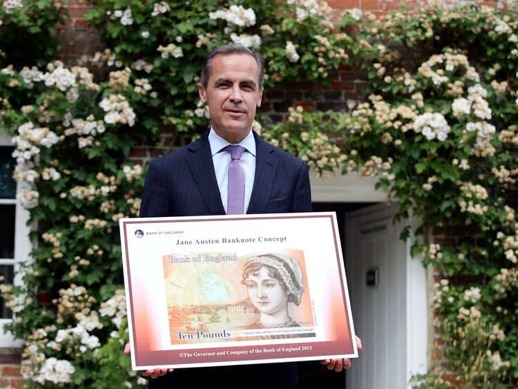 File picture of Bank of England governor Mark Carney holding the concept design for a £10note