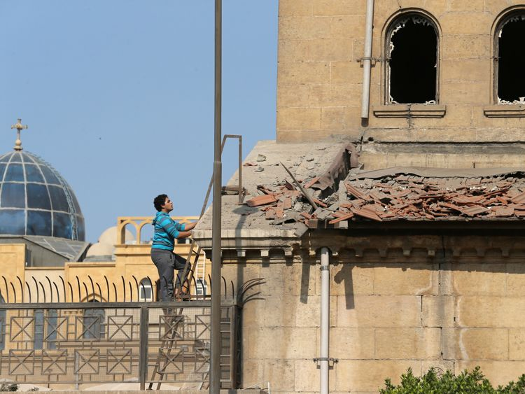 Windows are shattered and debris scattered after the bomb blast rocked the cathedral in Cairo
