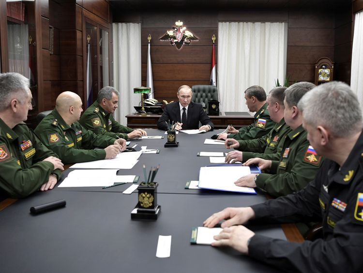 Vladimir Putin meets his military chiefs