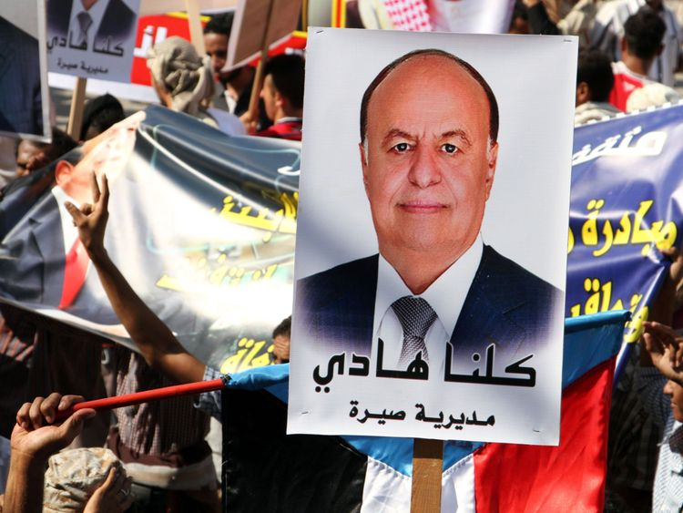 A poster of Saudi-backed Yemeni President Hadi - ' We are all Hadi' - at a rally in Aden