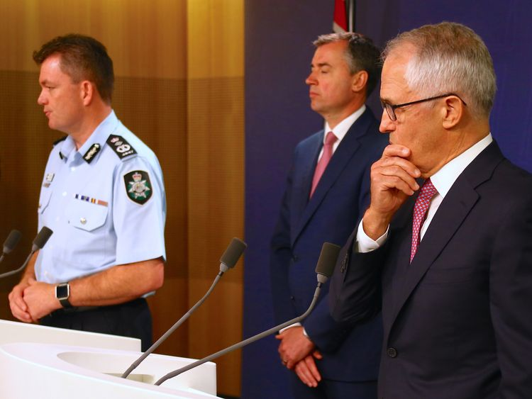 Malcolm Turnbull (R) at the news conference announcing that the alleged plot had been foiled