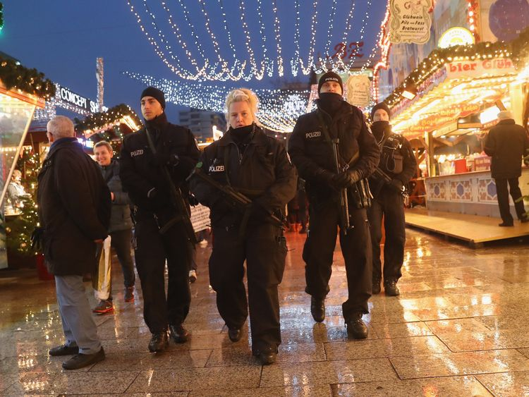 Police were patrolling as the market reopened
