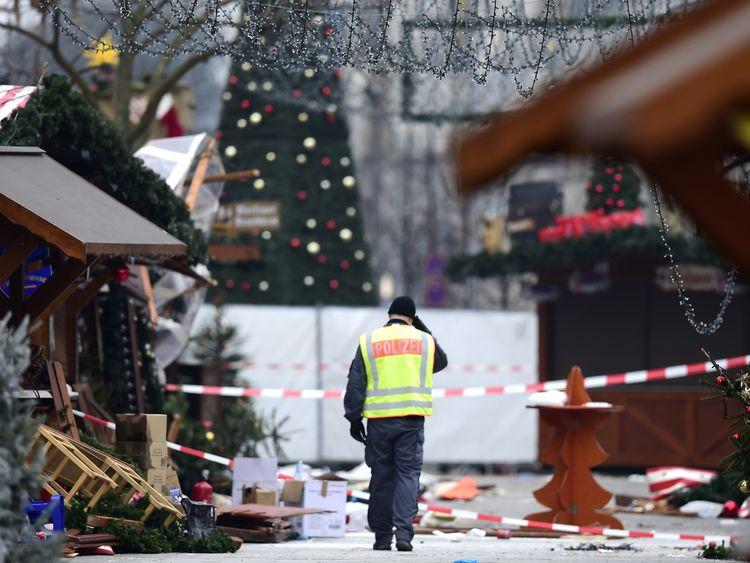A policeman walks through the damaged Christmas market