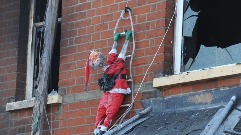 A charred Santa is a sad reminder of the family's festive hopes