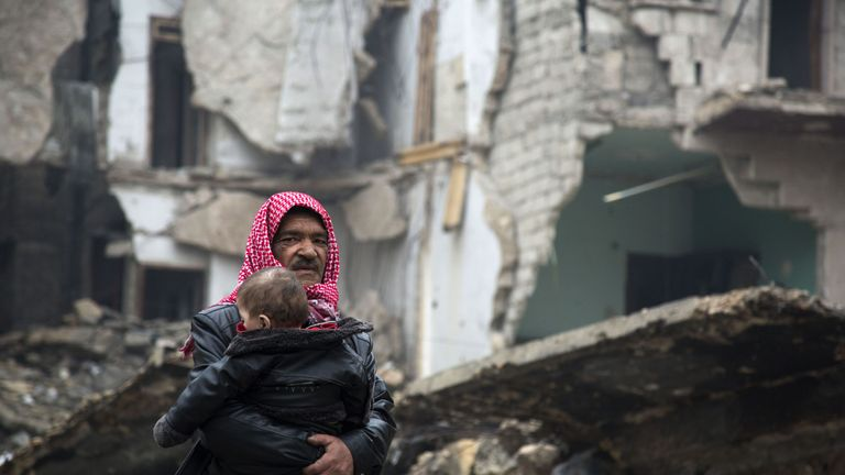 Syrians leave a rebel-held area of Aleppo