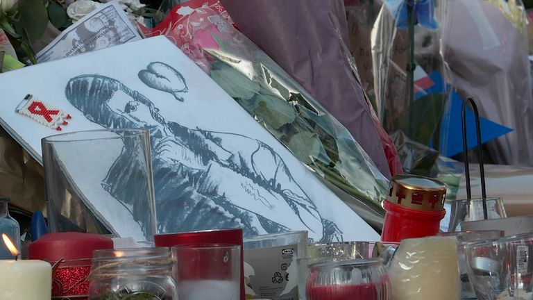 Candles, pictures and flowers have been placed along the walls of George Michael's North London residence.