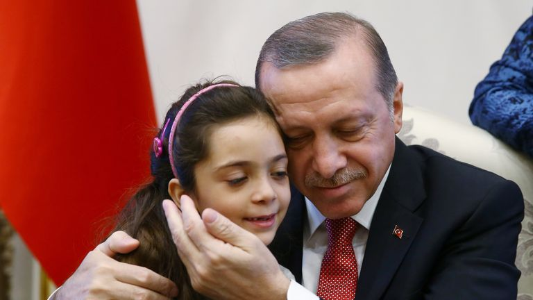 Turkish President Recep Tayyip Erdogan meets with Syrian girl Bana Alabed, known as Aleppo's tweeting girl, at the Presidential Palace in Ankara, Turkey, December 21, 2016