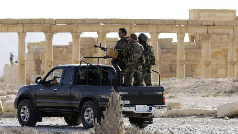 Members of the Syrian army patrol the ancient Syrian city of Palmyra