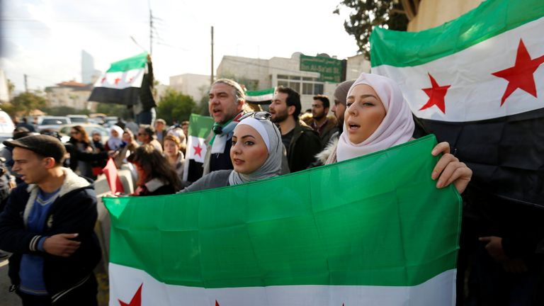 Protesters hold Syrian opposition flags and chant slogans during a sit-in, in solidarity with the people of Aleppo against the Syrian regime, in front of the UNDP office in Amman, Jordan, December 17, 2016