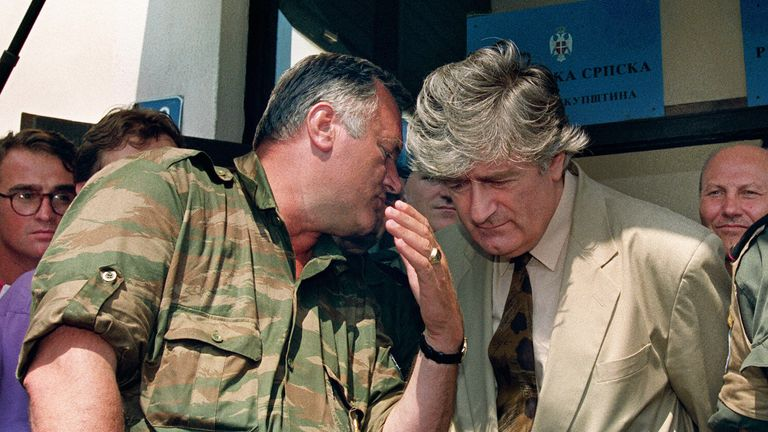Ratko Mladic whispers in the ear of Radovan Karadzic during a meeting in Pale, in August 1993