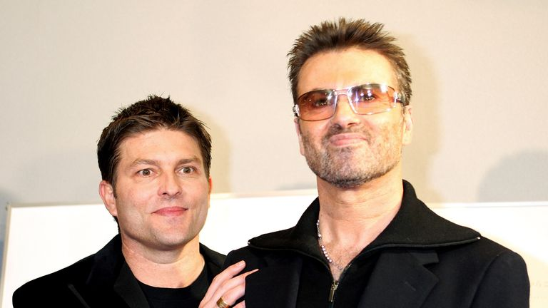 George Michael and his former partner Kenny Goss in 2005