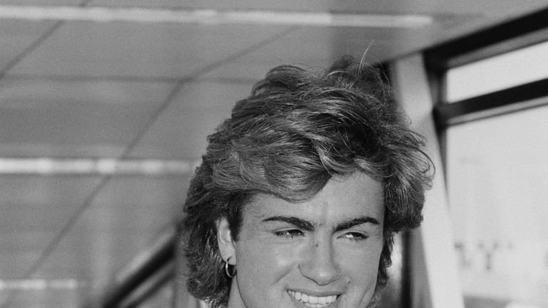 George Michael arriving at Heathrow Airport in August 1984.