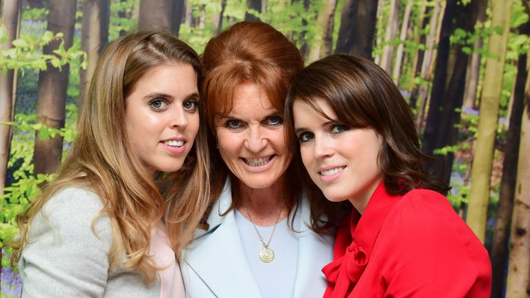 Princess Beatrice, the Duchess of York and Princess Eugenie meet young cancer patients and their families at the Teenage Cancer Trust's young persons unit at University College Hospital, London