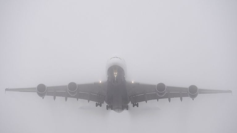 A British Airways Airbus A380 is shrouded in fog as it comes in to land at Heathrow Airport